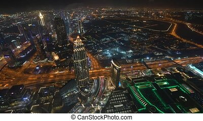 Dubai February 1. 2019 view from Burj Khalifa - downtown night scene with city lights, luxury new high tech town in middle East, United Arab Emirates architecture, transportation