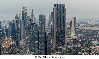 Dubai International Financial Centre district with modern skyscrapers day to night timelapse