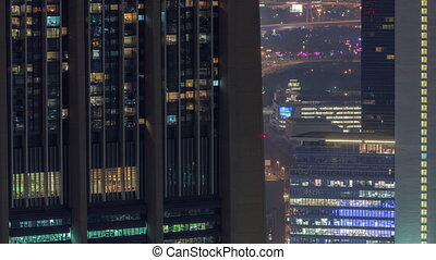 Dubai International Financial Centre district with modern skyscrapers night timelapse