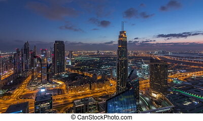 Dubai International Financial Centre district with modern skyscrapers night to day timelapse