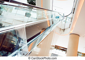Dubai Mall, interior of shopping center with escalators in bright interior