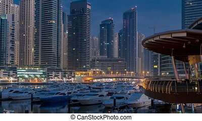 Dubai Marina at Blue hour night to day timelapse with yachts