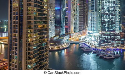 Dubai Marina at night timelapse, Glittering lights and...