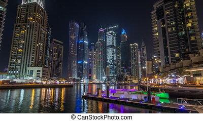Dubai marina bay with yachts an boats night timelapse...