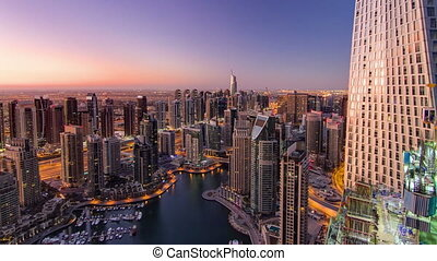 Dubai marina harbor from night to day transition timelapse