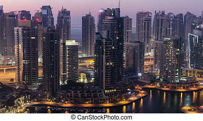 Dubai marina harbor from night to day transition timelapse close view