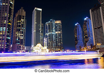 Dubai marina mosque with skyscrapers and light trails