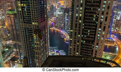 Dubai Marina night skyline time lapse. pan up
