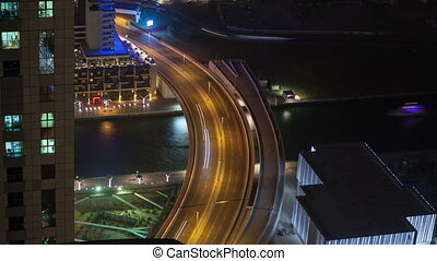 Dubai marina night street traffic time lapse. pan up