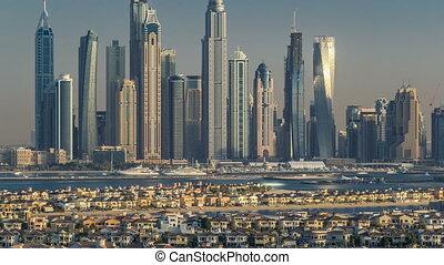 Dubai Marina skyline at sunset timelapse as seen from atlantis on Palm Jumeirah in Dubai, UAE.