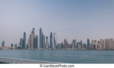Dubai Marina skyline day to night timelapse as seen from Palm Jumeirah in Dubai, UAE.