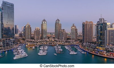 Dubai Marina skyscrapers aeral day to night timelapse, port...