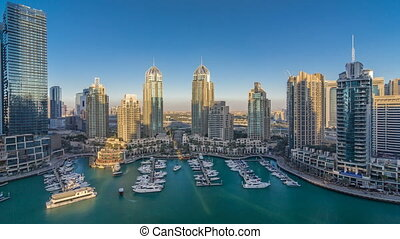 Dubai Marina skyscrapers aeral timelapse, port with luxury...