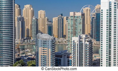 Dubai Marina skyscrapers aerial top view at morning from JLT...