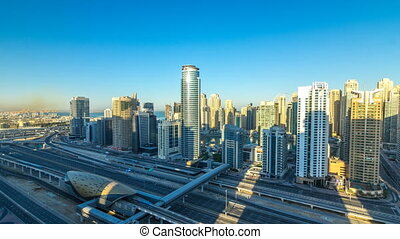 Dubai Marina skyscrapers aerial top view at sunrise from JLT...