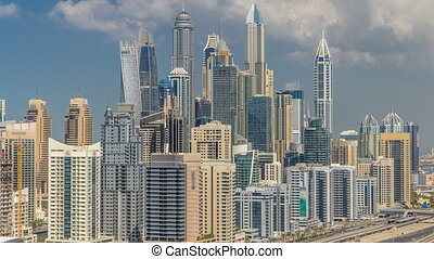 Dubai Marina skyscrapers aerial top view with clouds from JLT in Dubai timelapse, UAE.