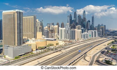 Dubai Marina skyscrapers aerial top view with clouds from...