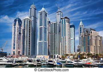 Dubai Marina with boats against skyscrapers in Dubai, United...
