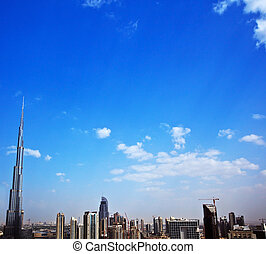 Dubai modern cityscape, downtown with blue sky background,...