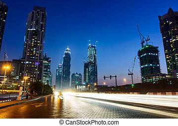 Dubai night city scene with light trails