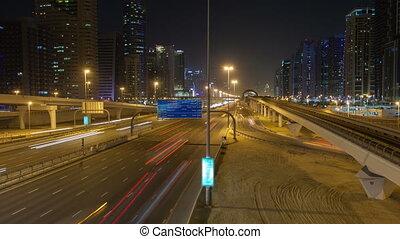 Dubai night traffic time lapse. pan up