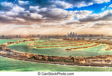 Dubai Palm Jumeirah. Aerial view with city skyline on background