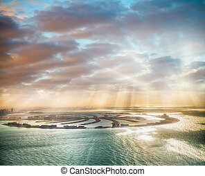 Dubai Palm Jumeirah Island with sun says