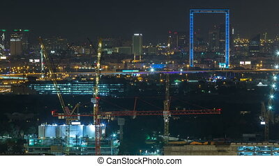 Dubai skyline night timelapse with illuminated landmarks....