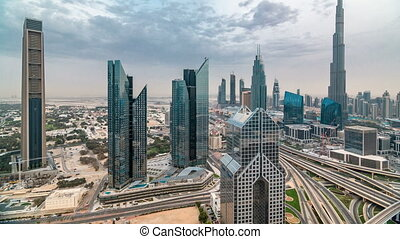 Dubai skyline timelapse at sunset with beautiful city center skyscrapers and Sheikh Zayed road traffic, Dubai, United Arab Emirates
