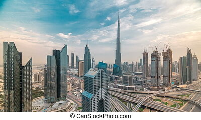 Dubai skyline timelapse at sunset with beautiful city center...