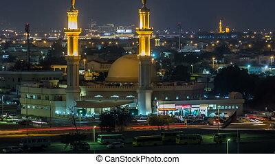 Dubai skyline with Mosque illuminated at night timelapse....