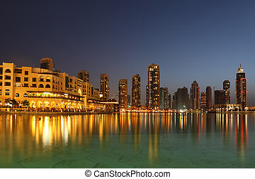 Dubai skyscrapers and other buildings at night time, view ...