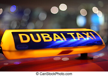 Dubai Taxi sign at night
