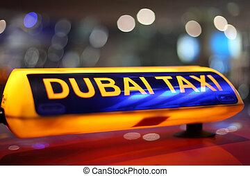 Dubai Taxi sign at night