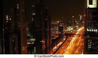 dubai traffic at night with skyscrapers.mov