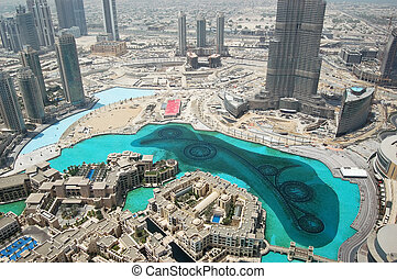 DUBAI, UAE - AUGUST 27: The Dubai downtown, Burj Dubai (Burj Khalifa) skyscraper,  Dubai Mall and man made lake with dancing fountains 27, 2009 in Dubai, United Arab Emirates