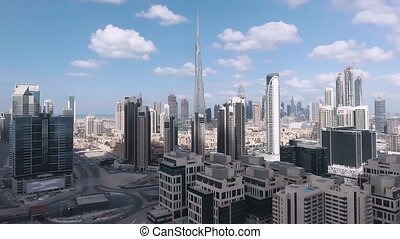 DUBAI, UAE - DECEMBER 8, 2016: Panoramic aerial view of Downtown skyscrapers with river and road.