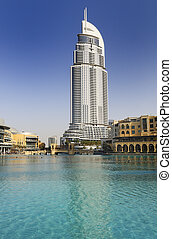 DUBAI, UAE - FEB 22: The Address Hotel in the downtown Dubai area overlooks the famous dancing fountains, taken on 22 February 2012 in Dubai. The hotel is surrounded by a mall, hotels and Burj Khalifa