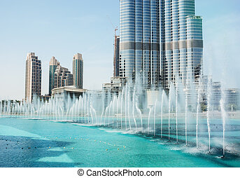 The Dancing fountains downtown and in a man-made lake in...