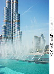 DUBAI, UAE - NOVEMBER 14: The Dancing fountains downtown and in a man-made lake in Dubai, UAE on November 14, 2012. The Dubai Dancing fountains are world's largest fountains with height 150 m.