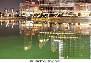 DUBAI, UAE - SEPTEMBER 9: The view on Burj Khalifa and man-made lake. It is the world's tallest skyscraper (height 828m, 160 floors) on September 9, 2013 in Dubai, UAE
