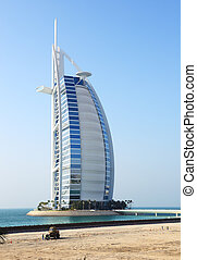 """DUBAI, UAE - SEPTEMBER 9: The view on world's first seven stars luxury hotel Burj Al Arab """"Tower of the Arabs"""" and costruction site for a new hotel on September 9, 2013 in Dubai, United Arab Emirates"""