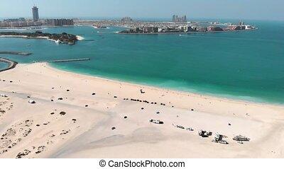 Dubai's city Al Sufouh Beach from a great height. Aerial.