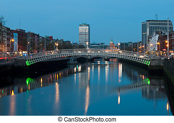 stunning nightscene with Ha'penny bridge and Liffey river, the Custom House landmark at the background (picture taken after sunset)