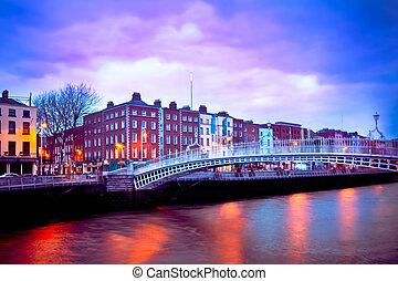 Dublin Ireland at dusk with waterfront and historic Ha'penny Bridge