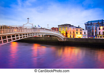 Dublin Ireland at dusk with waterfront and historic Ha'penny...