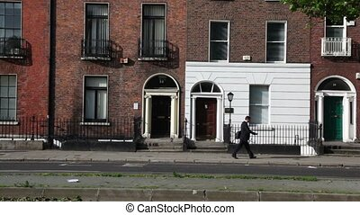 People and cars on street with georgian doors - DUBLIN -...