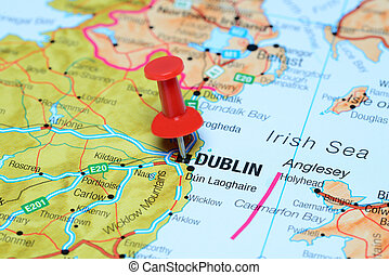 Photo of pinned Dublin on a map of europe. May be used as illustration for traveling theme.