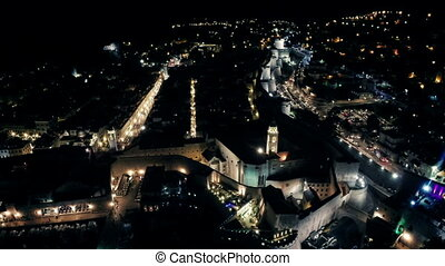 Aerial view of Dubrovnik old town by night.