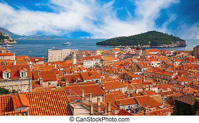 Dubrovnik red roofs and green island Lokrum